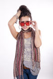 Young attractive girl with funny red sunglasses. Young beautiful angry girl wearing funny red sunglasses Stock Photo