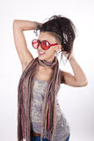 Young attractive girl with funny sunglasses. Young beautiful girl wearing funny sunglasses and smiling Royalty Free Stock Photo