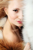 Young attractive girl with fur coat. Fashion portrait Royalty Free Stock Photo
