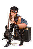 Young attractive girl on guitar amp Royalty Free Stock Photos