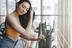 Young attractive girl at gym on exercise bike, fitness and yoga stock photography