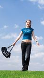 The young attractive girl with a handbag Stock Photos