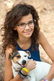 Young attractive girl with her dog. Royalty Free Stock Photography