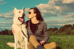Young attractive girl with her pet dog Royalty Free Stock Images