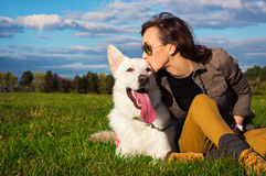 Young attractive girl with her pet dog Royalty Free Stock Photography