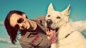 Young attractive girl with her pet dog Stock Images