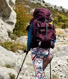 Young  attractive girl hiking on rocky mountin. Young attractive girl hiking in mountins Stock Photography