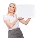 Young attractive girl holding empty message board Royalty Free Stock Image