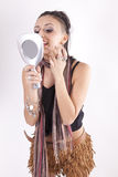 Young attractive girl holding a mirror. Young attractive sexy girl looking at the mirror Stock Image