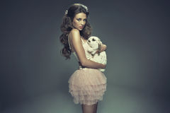 Young attractive girl hugging a rabbit Royalty Free Stock Photography