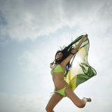 Young attractive girl jumping with Brazil flag in the air. Young attractive girl in bikini jumping with Brazil flag in the air Stock Image