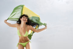 Young attractive girl jumping with Brazil flag in the air Stock Images