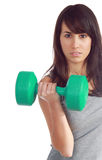 Young attractive girl lift a weight Royalty Free Stock Photos