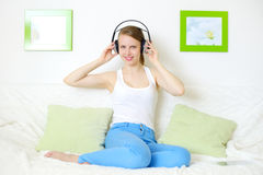 Young attractive girl listening to music Royalty Free Stock Image