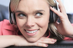 Young attractive girl listening to the music in Royalty Free Stock Image