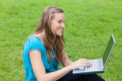 Young attractive girl looking at her laptop Royalty Free Stock Image