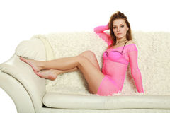 Young and attractive girl lying on white sofa Stock Photo