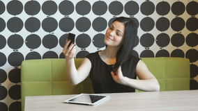 Young attractive girl making selfie photo stock footage