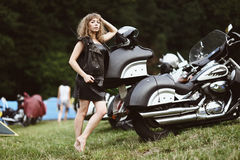 Young attractive girl and motorcycle Stock Images
