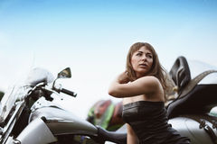Young attractive girl and motorcycle Stock Image