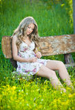 Young attractive girl outdoor on the field Stock Image