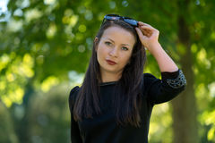 Young attractive girl in the park Stock Photo
