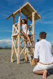 Young attractive girl posing on a lifeguard tower Stock Images