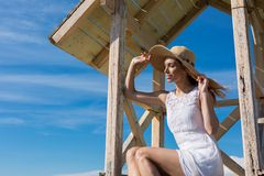 Young attractive girl posing on a lifeguard tower Stock Photography