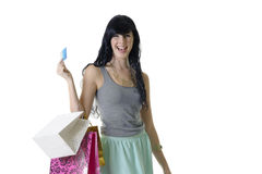 Young attractive girl presenting her banking card for purchases Royalty Free Stock Photos