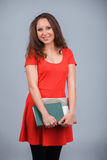 Young attractive girl in red with folders Stock Photography