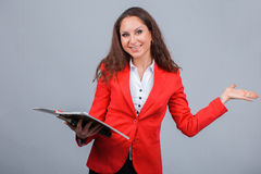 Young attractive girl in red with folders Royalty Free Stock Photos