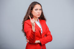 Young attractive girl in red with folders Royalty Free Stock Images