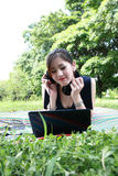 Young attractive girl is relaxing in the park Royalty Free Stock Photo