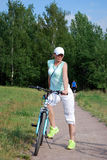 The young attractive girl rides a bike in the summer. Sports way of life Stock Photos