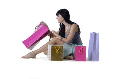 Young attractive girl sitting with all her new purchases Royalty Free Stock Image