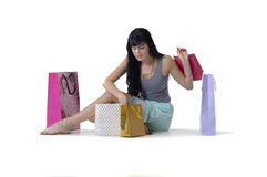 Young attractive girl sitting with all her new purchases Stock Images