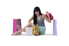 Young attractive girl sitting with all her new purchases Stock Photography