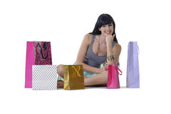Young attractive girl sitting with all her new purchases Stock Image