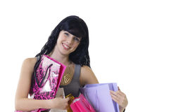 Young attractive girl sitting with all her new purchases Royalty Free Stock Photography