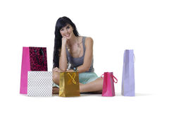 Young attractive girl sitting with all her new purchases Royalty Free Stock Photos