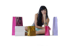 Young attractive girl sitting with all her new purchases Royalty Free Stock Images