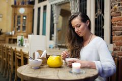 Young attractive girl sitting in the evening in a cafe stock photos