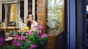Young attractive girl sitting in the evening in a cafe stock images