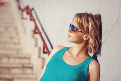 Young attractive girl summer sunlight city fashion portrait. Casual style with sunglasses stock photography