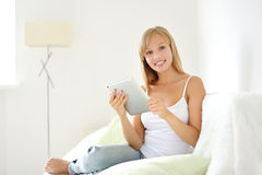 Young attractive girl with tablet pc Stock Image