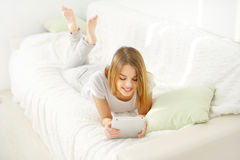 Young attractive girl with tablet pc Stock Images