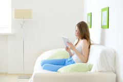 Young attractive girl with tablet pc Stock Photography