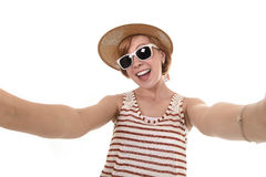 Young attractive girl taking selfie photo portrait with mobile phone with summer dress in chic trendy tourist look Royalty Free Stock Image