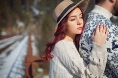 Young attractive girl traveller with her lover on the bridge royalty free stock photography