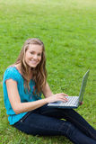 Young attractive girl using her laptop Stock Images